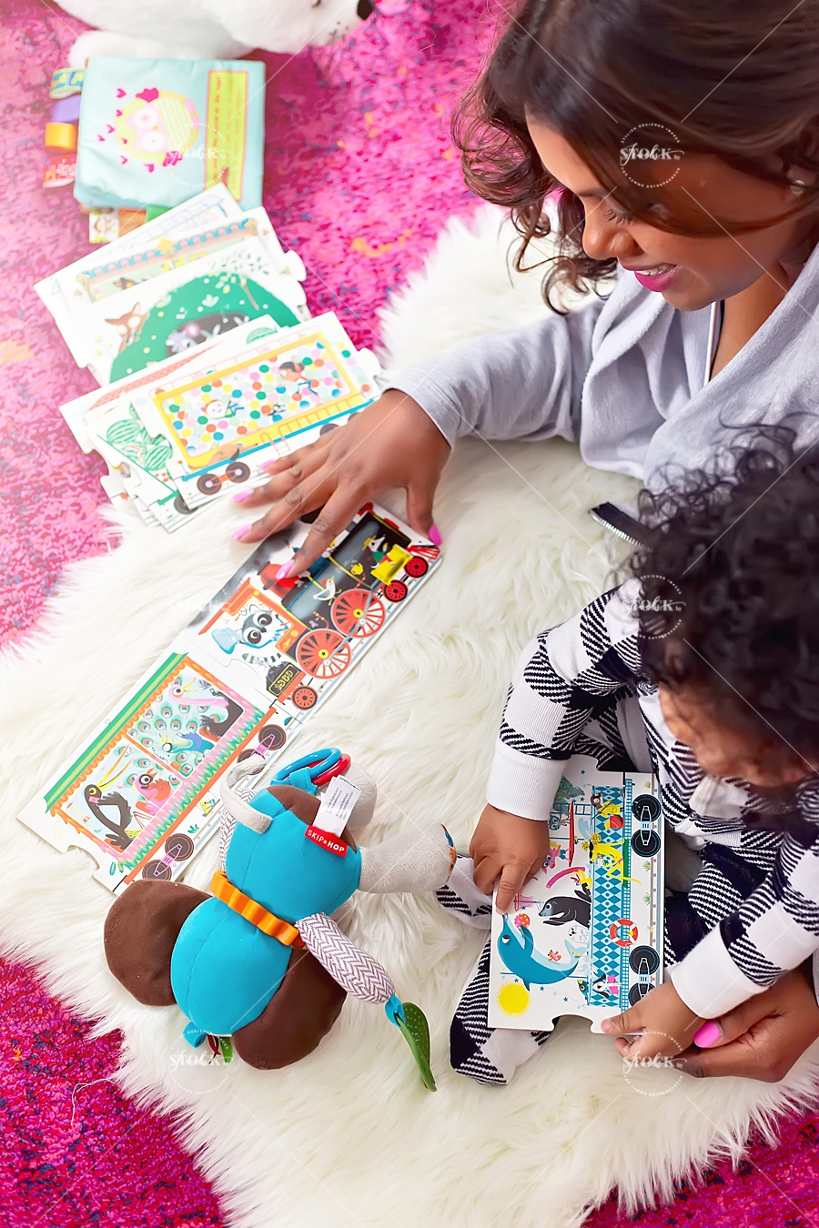mother and baby playing with books and toys