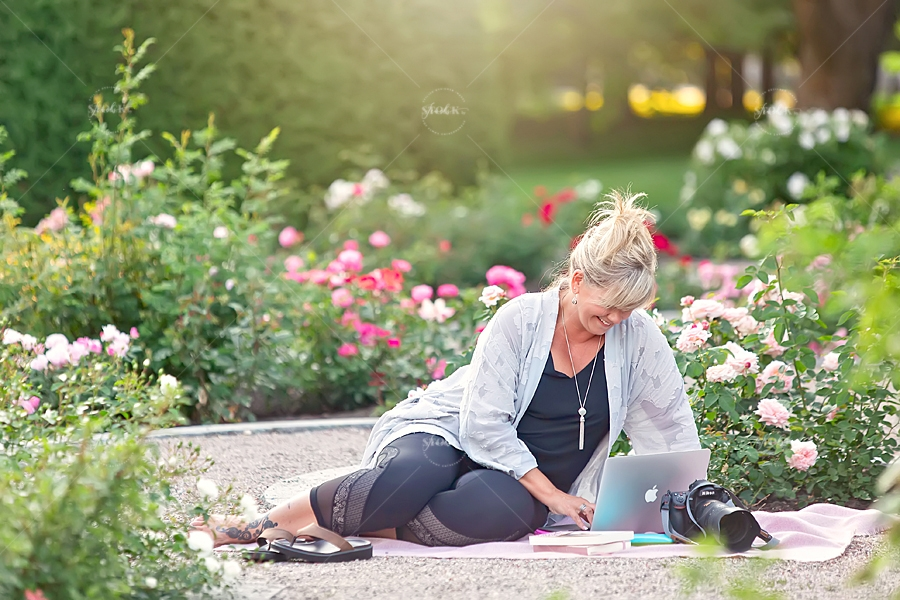 Middle aged female entrepreneur working in a rose garden in Ottawa